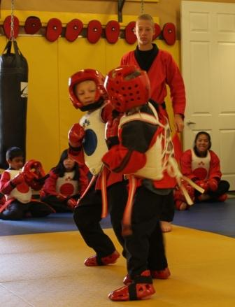 children sparring at karate tournament