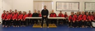Grandmaster Allen Sarac with his Black Belts at Karate Testing